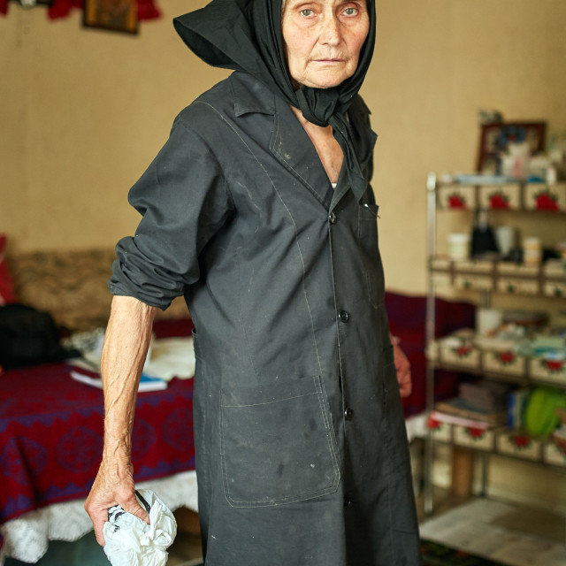 """Expressive rural old woman indoor"" stock image"