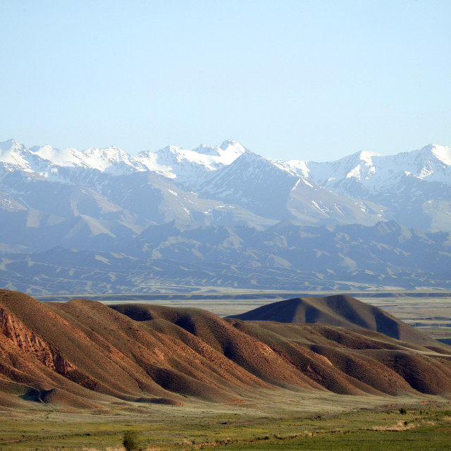 """Distant Mountains In Kyrgyzstan"" stock image"