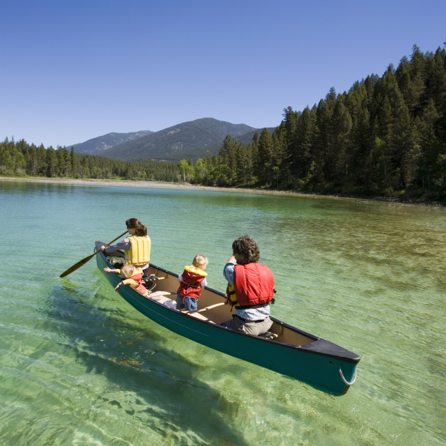 """""""Young Family Canoeing On Loon Lake In The East Kootenays, British Columbia,..."""" stock image"""