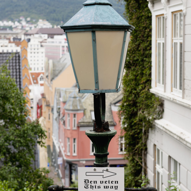 """""""Directional Sign With Arrows Posted On A Light Post; Bergen, Norway"""" stock image"""