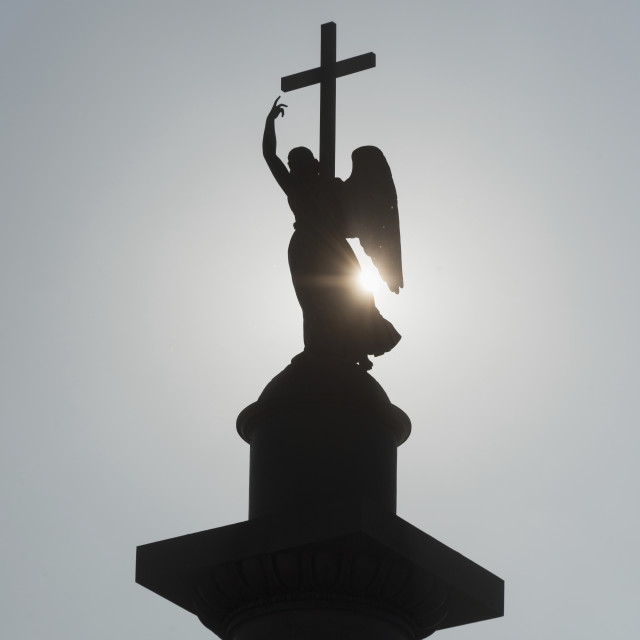 """Silhouette Of An Angel Statue And Cross; St. Petersburg, Russia"" stock image"