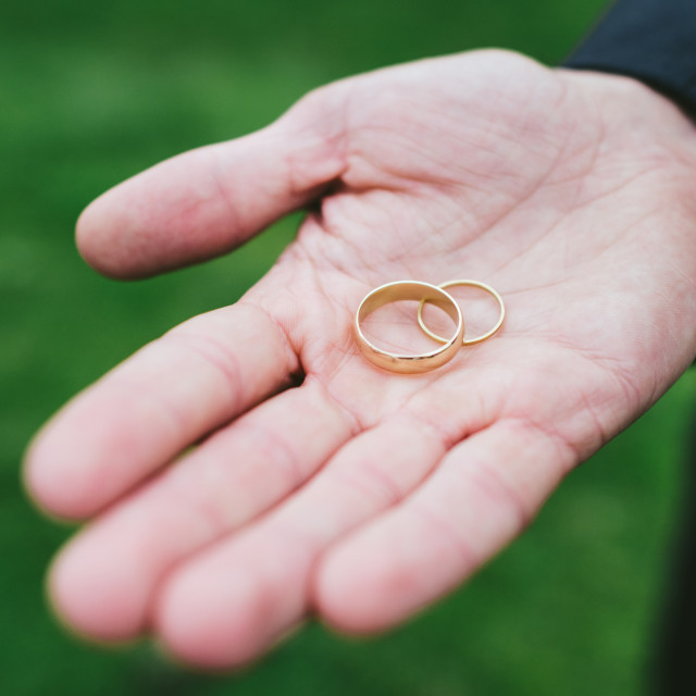 """""""Gold wedding rings in hand"""" stock image"""