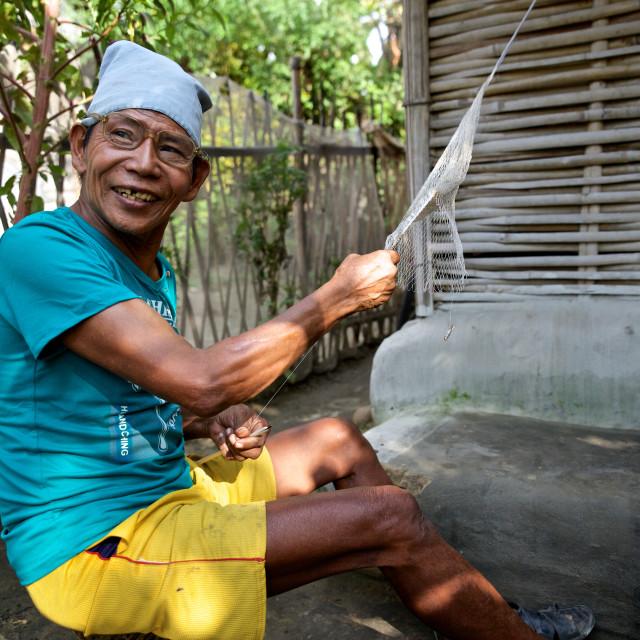 """Beldangi II, Damak, Nepal, 2014: Ashros Rai of age 64, awaits to join his son..."" stock image"
