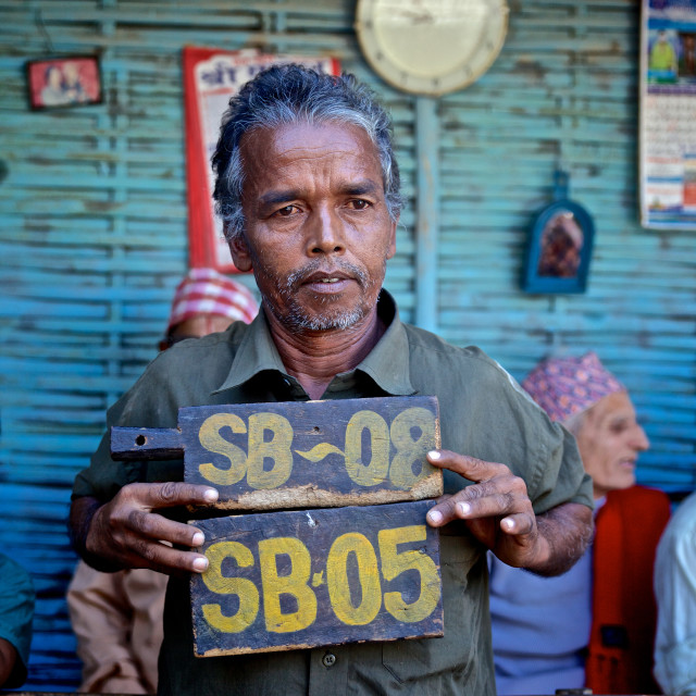 """- Beldangi II, Damak, Nepal, 2014: This man is holding on to the number plate..."" stock image"