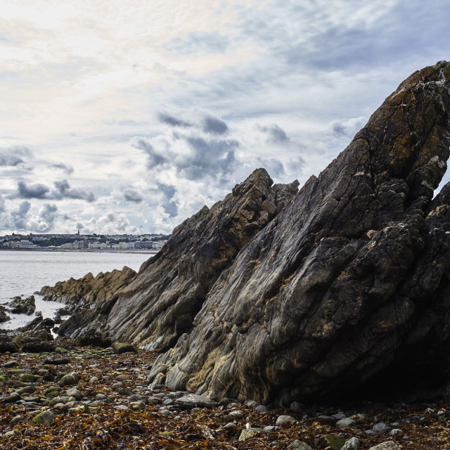 """Rock formations at Port Jack, Douglas, Isle of Man"" stock image"