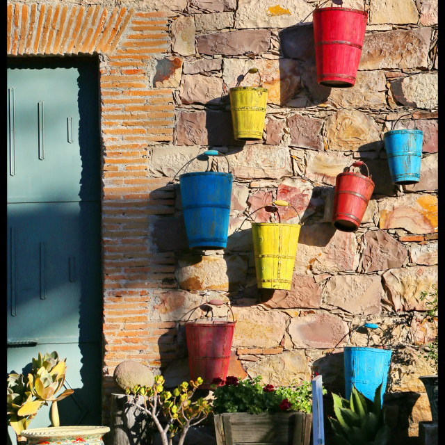 """Buckets on the wall"" stock image"