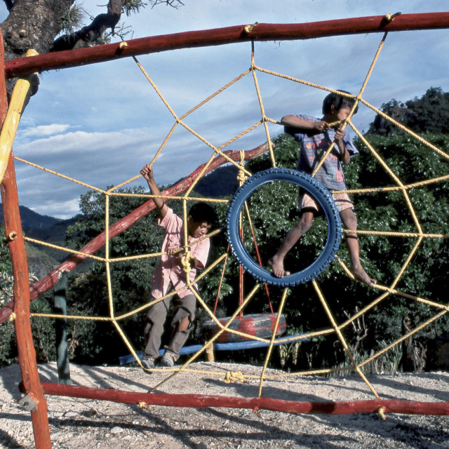 """Children from the Ex-Civil War Refugee community recreating at a playground,..."" stock image"
