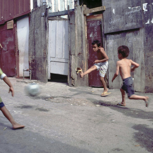 """CHILDREN PLAYING FOOTBALL IN THE SHANTY TOWNS OF SANTOS, BRAZIL. Photo ©..."" stock image"