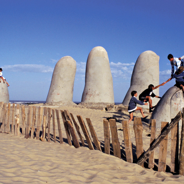 """Children playing games. Playa Brava, Punta Del Este. Uruguay."" stock image"
