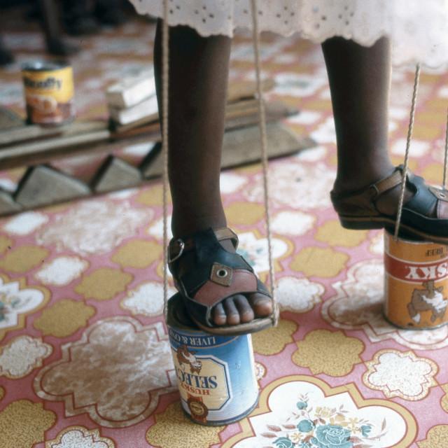 """""""Walking on improvised stilts. Maputo, Mozambique."""" stock image"""