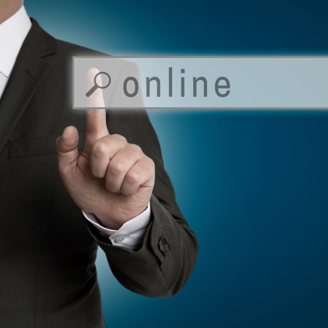 """""""Online internet browser is operated by businessman"""" stock image"""