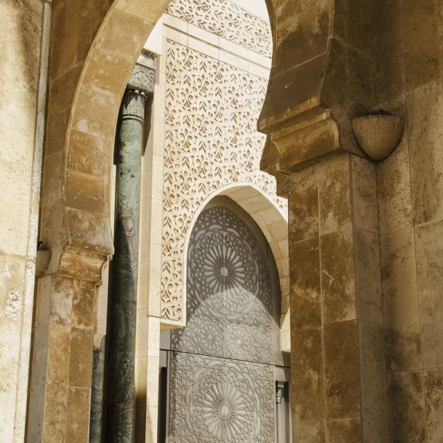 """Ornate facade on walls with arches in hassan ii mosque;Casablanca morocco"" stock image"