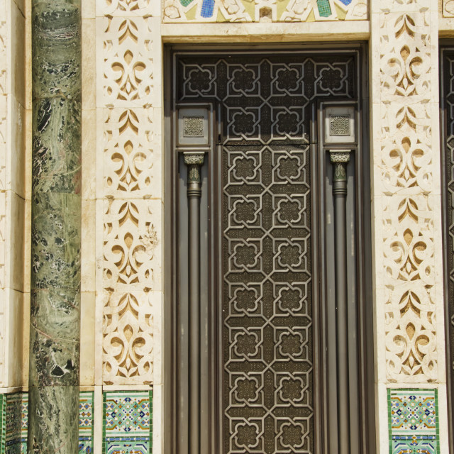 """Ornate detail on the wall and door at the hassan ii mosque;Casablanca morocco"" stock image"