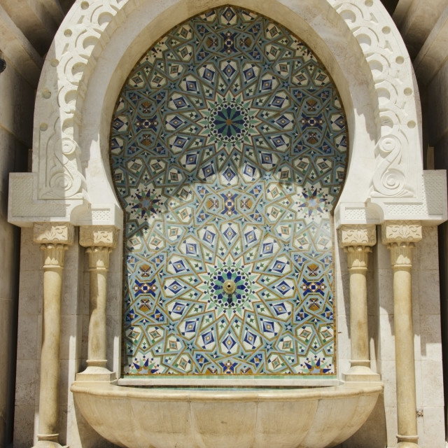 """Decorative facade on an arched structure at hassan ii mosque;Casablanca morocco"" stock image"