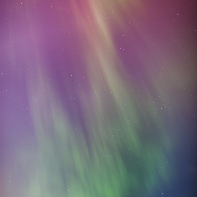 """""""A green and red northern lights corona in the sky above the tony knowles..."""" stock image"""
