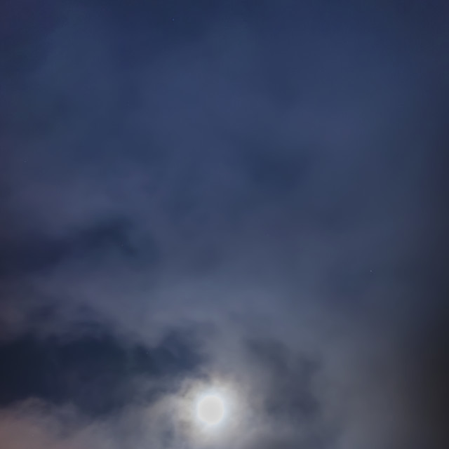 """""""The full moon sets through the fog above the tony knowles coastal trail in..."""" stock image"""