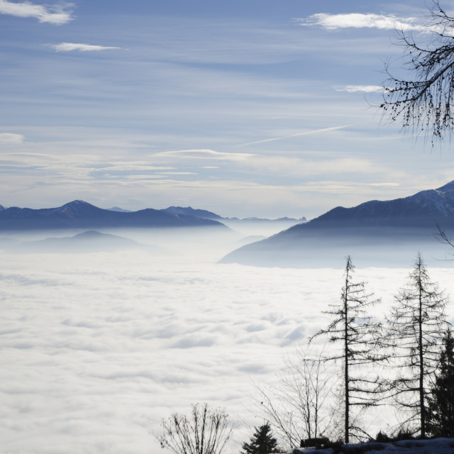 """Billows of fog rolling over the landscape;Locarno ticino switzerland"" stock image"