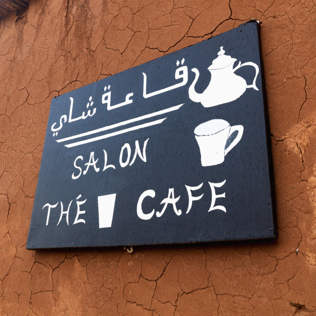 """A bilingual sign for a cafe"" stock image"