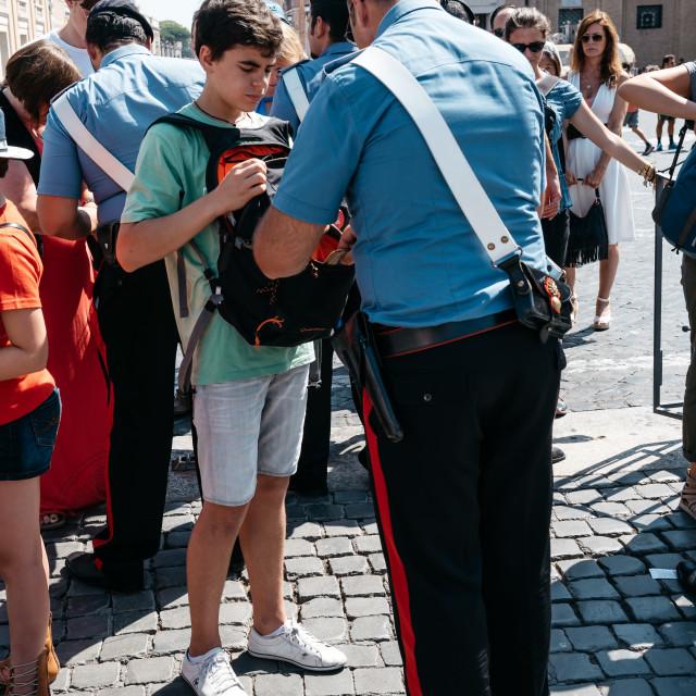"""Policeman inspecting bags of pilgrims in Vatican"" stock image"