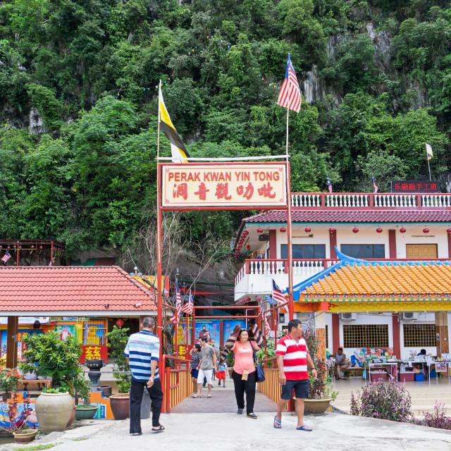 """Ipoh, Malaysia - September 17, 2017: Buddha statues at Perak Kwan Yin Tong temple in Perak. Built beside a limestone hill, this ancient Buddhist temple honors goddess of mercy Kwan Yin Tong."" stock image"