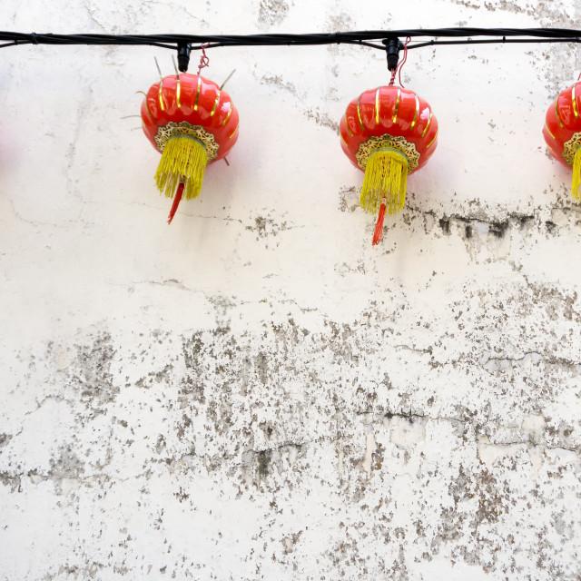 """Chinese lanterns on grunge wall concrete background"" stock image"