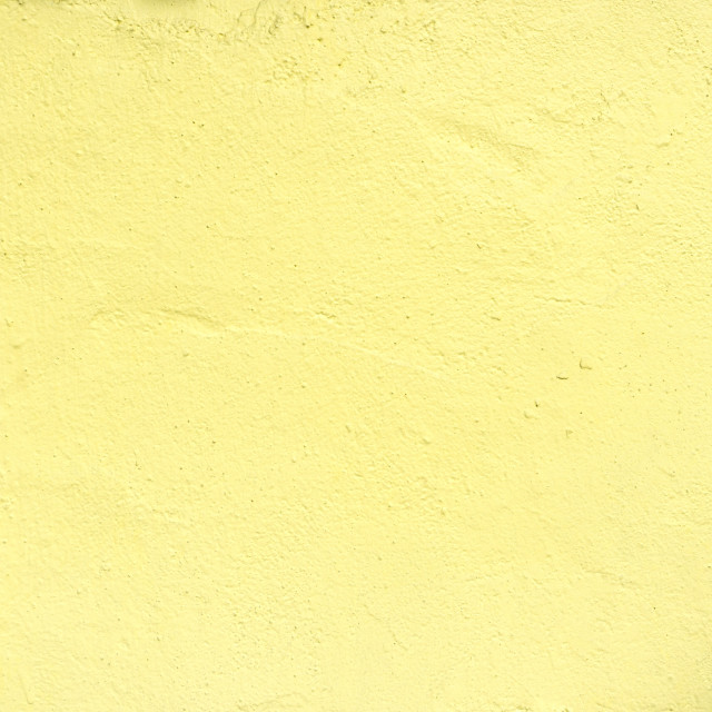 """Textures of pastel yellow painted grunge concrete background"" stock image"