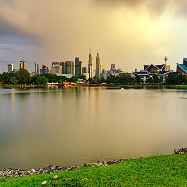 """Dramatic storm sunset over Kuala Lumpur skyline, capital city of Malaysia as seen from Taman Tasik Titiwangsa."" stock image"