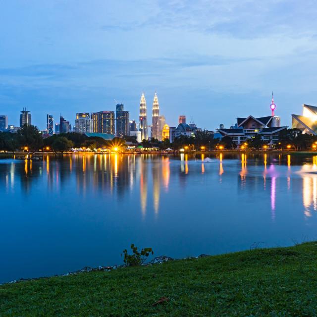 """Blue hour view of Kuala Lumpur skyline, capital city of Malaysia as seen from Taman Tasik Titiwangsa."" stock image"