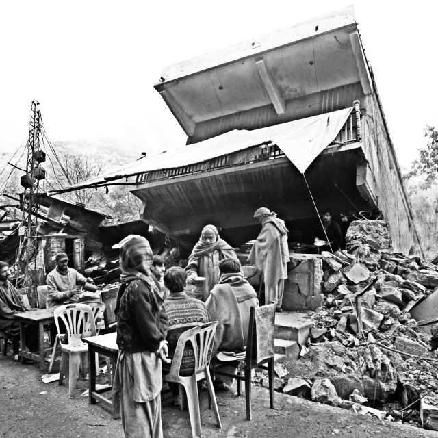 """Not far from the river Neelum, a demolished restaurant is open for business..."" stock image"