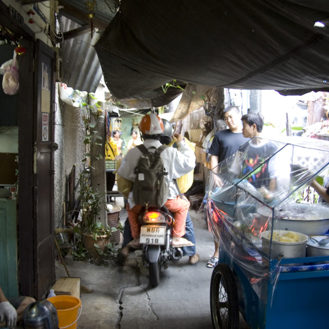 """Motorbiking on back street in Bangkok. Thailand, January 18, 2007."" stock image"