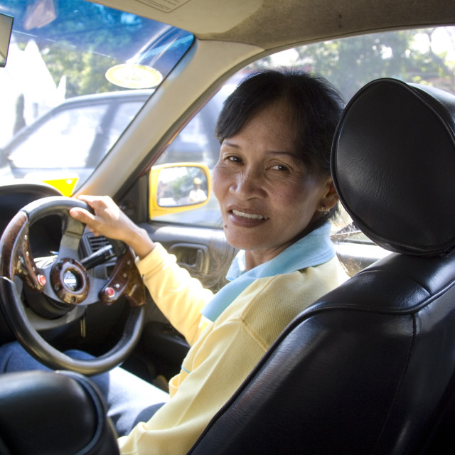 """Thai woman working as a taxi driver. Thailand, January 18, 2007."" stock image"