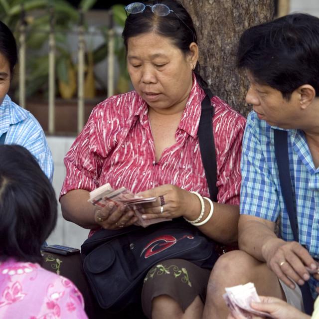 """Roadside vendors distributing cash. Thailand. January 16, 2007."" stock image"