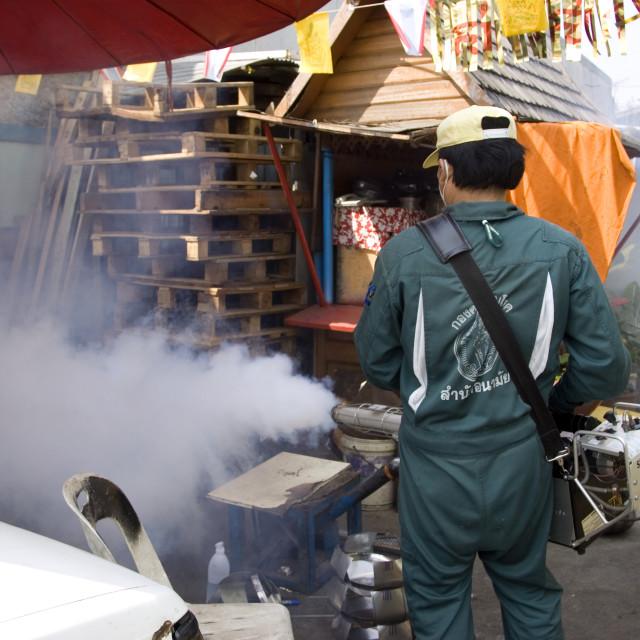 """""""Fumigating back streets of Bangkok. Thailand. January 18, 2007."""" stock image"""