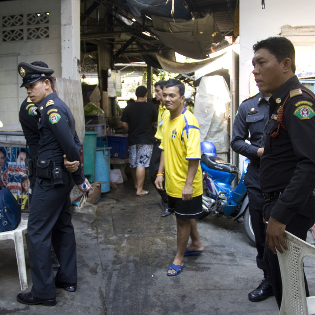 """Policemen in market place. Thailand. January 18, 2007."" stock image"