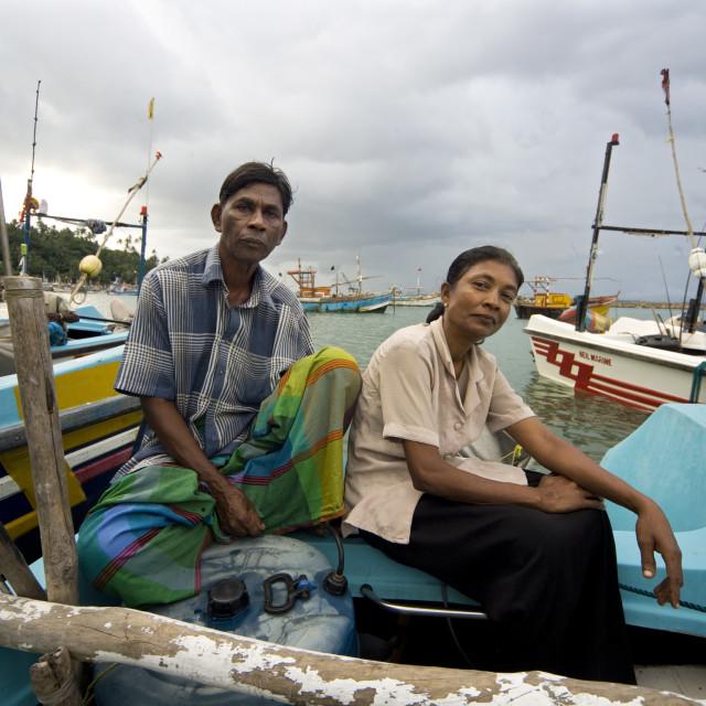"""Fisherman Sudurikku Ganadsa, 57, with his wife Francisco Baduge Roslin, 50,..."" stock image"