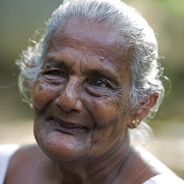 """J Muthamal, 67 years old. She has never married and lives alone. November 22,..."" stock image"
