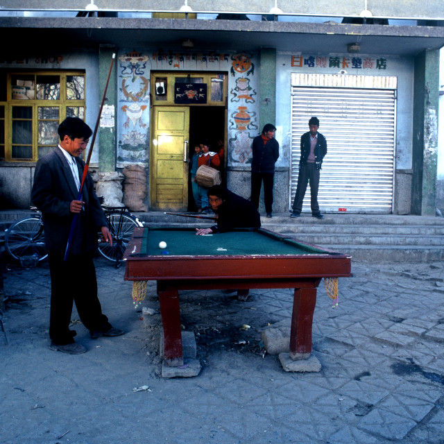 """Men playing snooker. Tibet, China."" stock image"