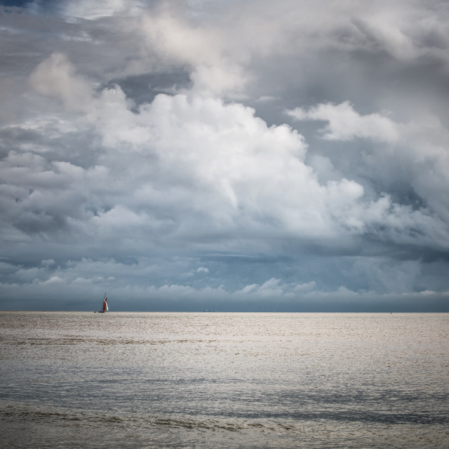 """Small Yacht Big Skies Off Frinton Beach"" stock image"