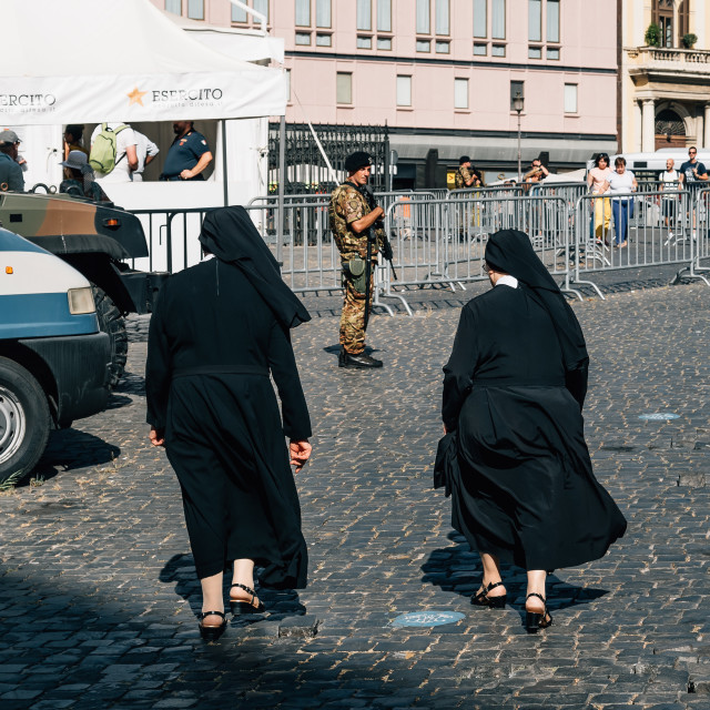 """Two nuns in military control in Rome"" stock image"