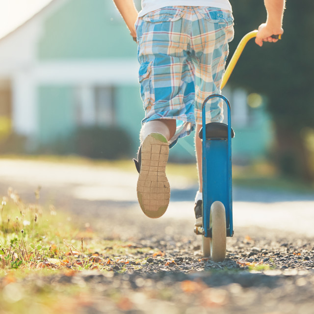 """Boy with push scooter"" stock image"