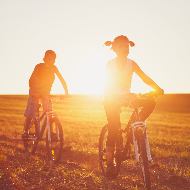 """Bike ride at the sunset"" stock image"
