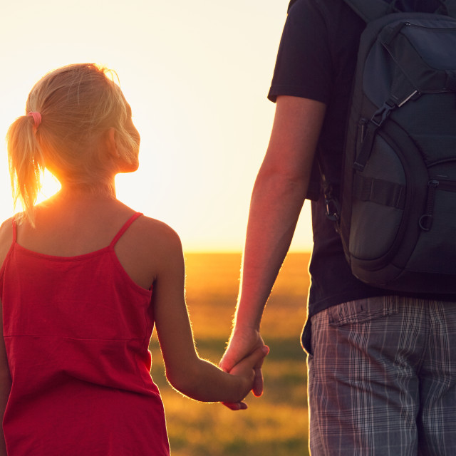 """Girl holding hand his father"" stock image"