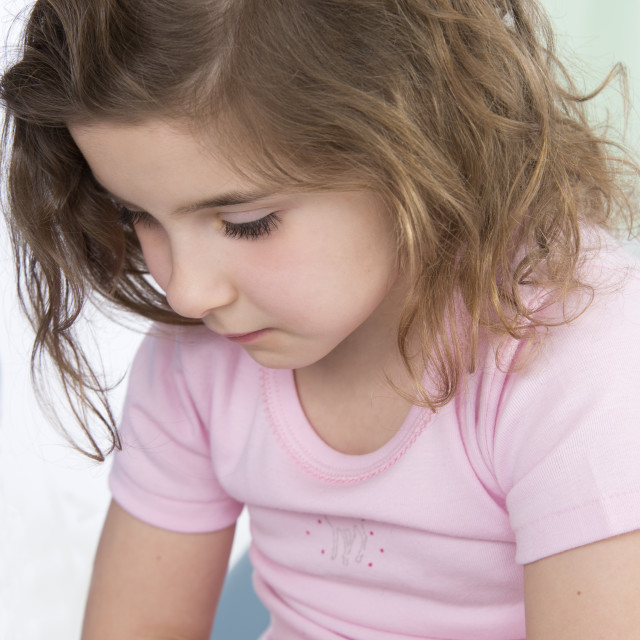 """""""Girl with tummy ache"""" stock image"""