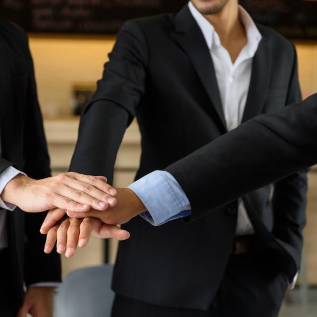 """businessman team touching hands, teamwork"" stock image"