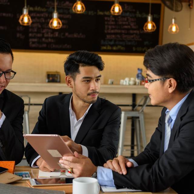 """""""businessman team discuss project at coffee cafe"""" stock image"""