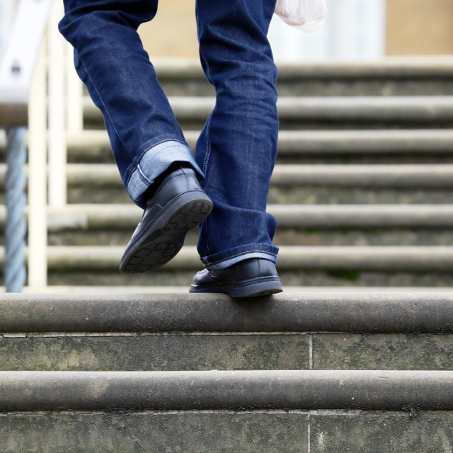 """Person walking up steps"" stock image"