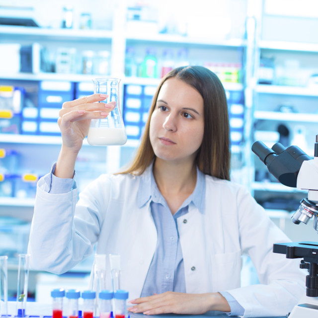 """Scientist holding a glass beaker"" stock image"