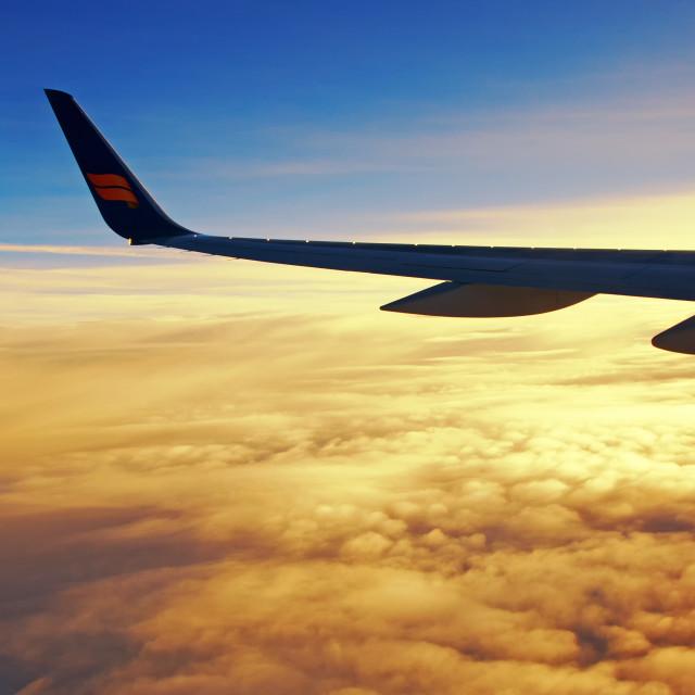 """Reykjavik, Iceland - September 23, 2013: Icelandair airplane's wing with logo during sunrise."" stock image"