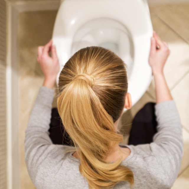 """""""Pregnant woman with morning sickness"""" stock image"""