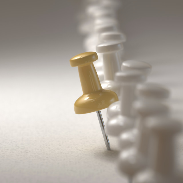 """Yellow push pin standing out from the crowd"" stock image"